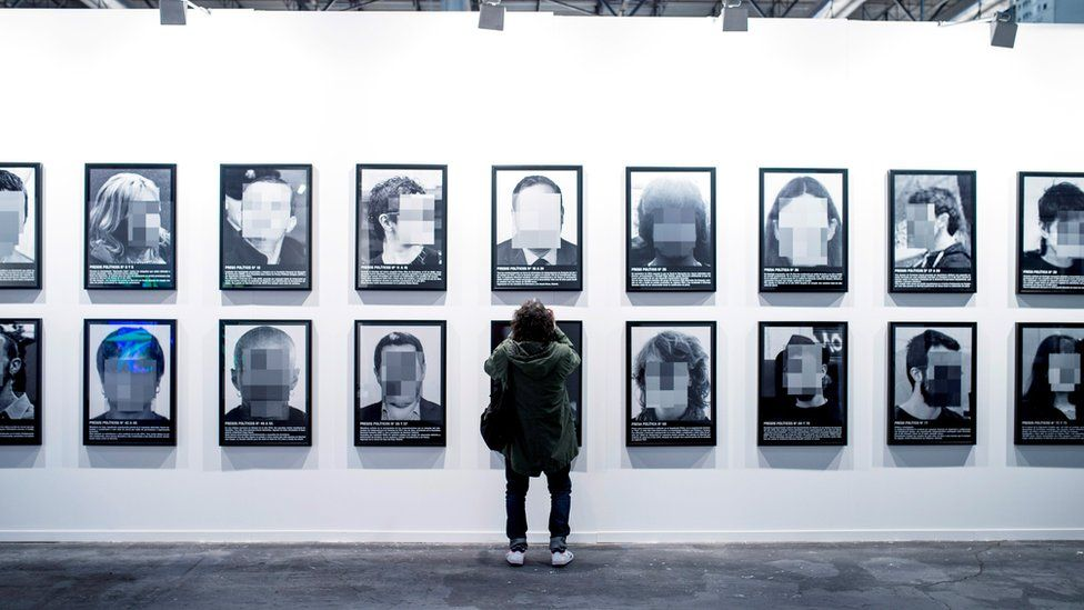 "A view of the artwork ""Presos politicos"" (Political prisoners) by Spanish artist Santiago Sierra of Santiago Sierra"