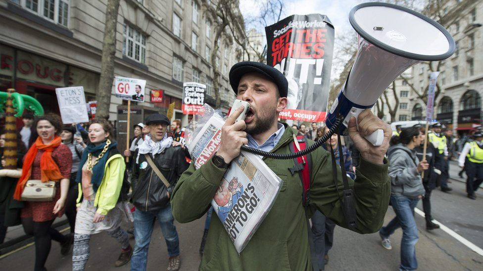 Protesters taking part in a demonstration calling for the resignation of British Prime Minister David Cameron