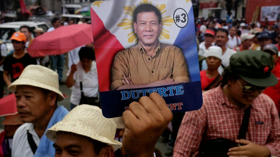 Leftist activists march in Manila to show support for Rodrigo Duterte during his oath to office on June 30, 2016 in Manila, Philippines.