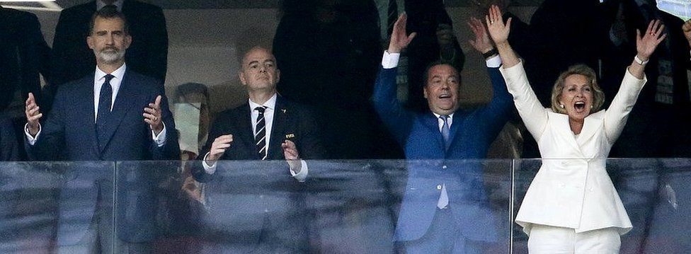Russia's prime minister (2nd R) was all smiles, unlike Spain's King Felipe VI, as they watched Russia qualify for the quarter finals on Sunday