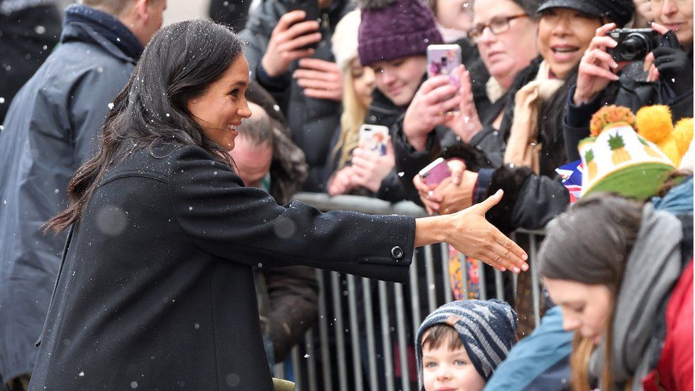 Meghan meeting crowds during a visit to Bristol