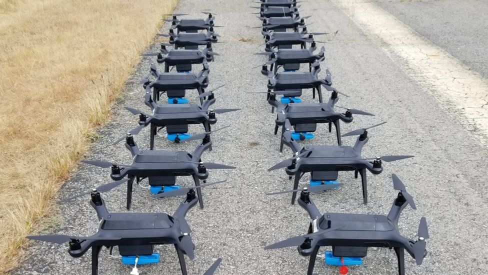 Many drones on the ground in rows