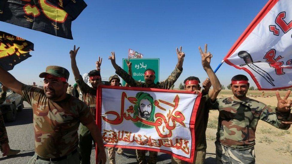 Shia Popular Mobilisation Forces (PMF) celebrate on the outskirts of Kirkuk (17 October 2017)