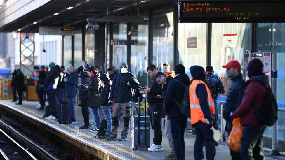 Commuters waiting at a Tube platform
