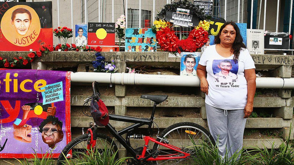 Gail Hickey stands next to a makeshift memorial for her son TJ who died during a police pursuit in 2004.