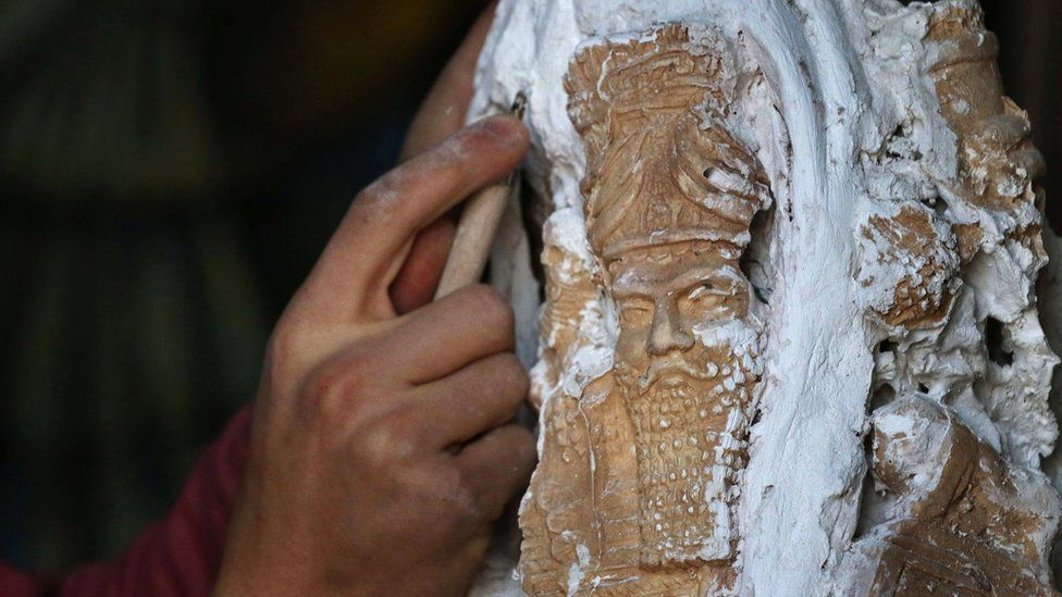 Ninos Thabit, an 18-year-old displaced Iraqi Christian who fled his hometown near Mosul due to the fighting between Iraqi forces and so-called Islamic State, recreating a historical Assyrian sculpture, one of the many destroyed by IS fighters in the ruins of Nineveh, 22 February 2017
