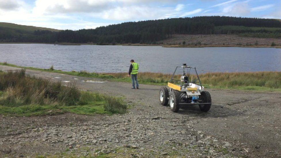 Aberystwyth robot Idris and Dr Mark Neal