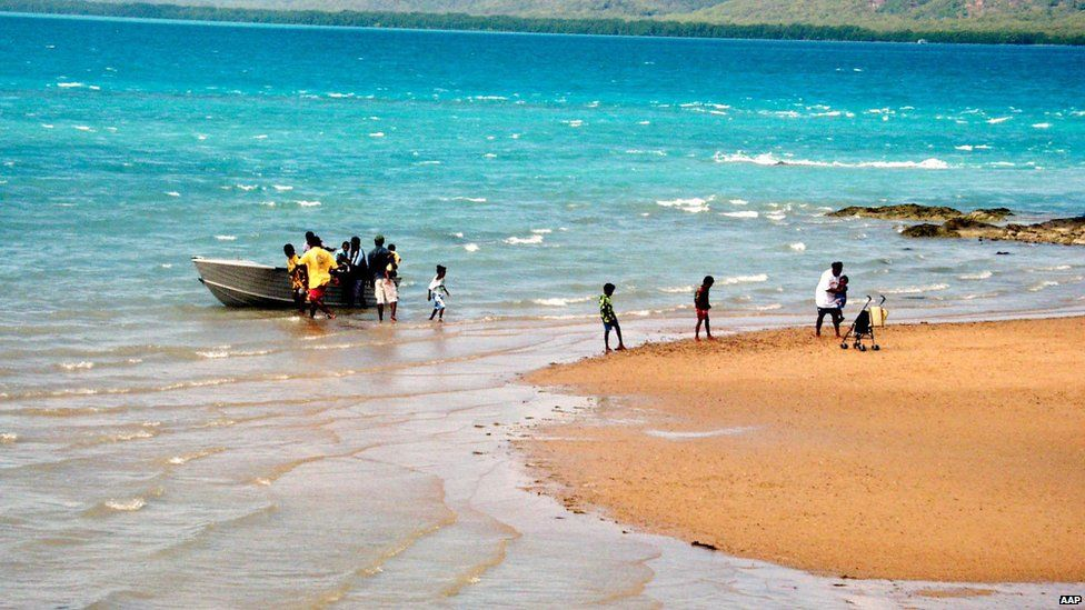 A family disembarks from their boat at Thursday Island in the Torres Strait, Australia