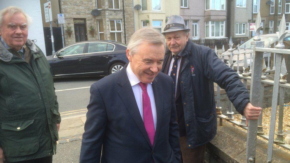 Ieuan Wyn Jones arrives at the meeting on Wednesday