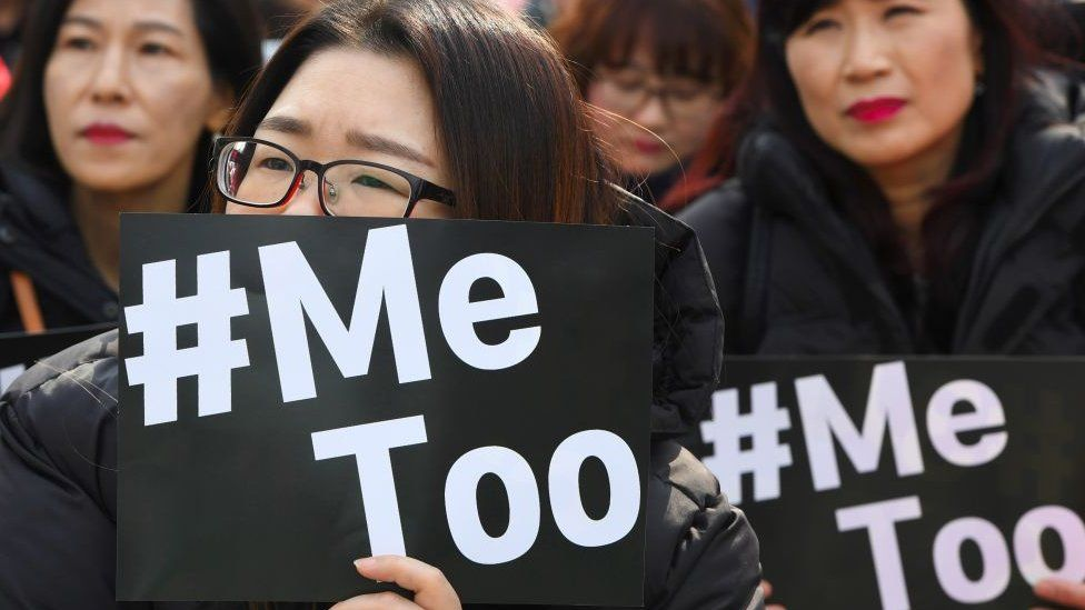 South Korean demonstrators hold banners during a rally to mark International Women's Day as part of the country's #MeToo movement in Seoul on March 8, 2018