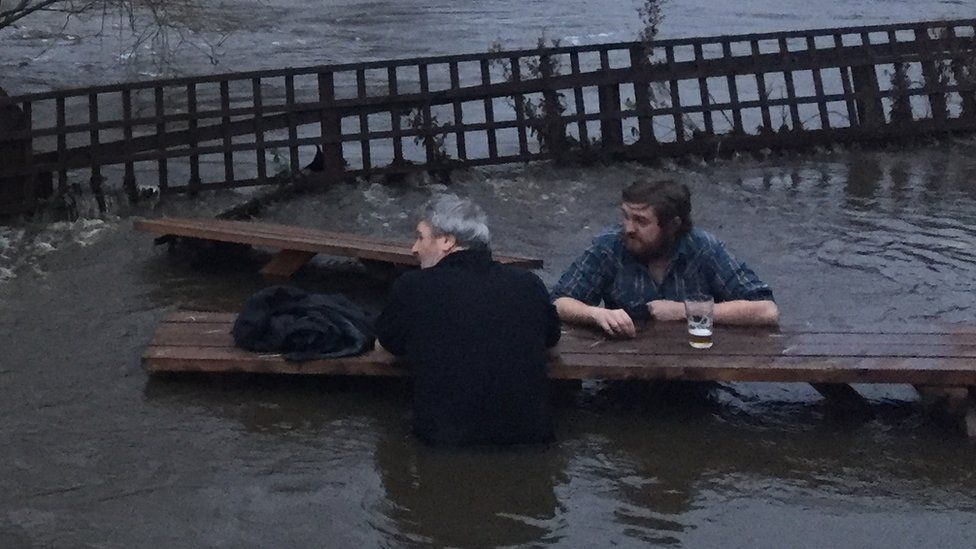 John Kelly and Steve Holt having a pint in a flooded beer garden