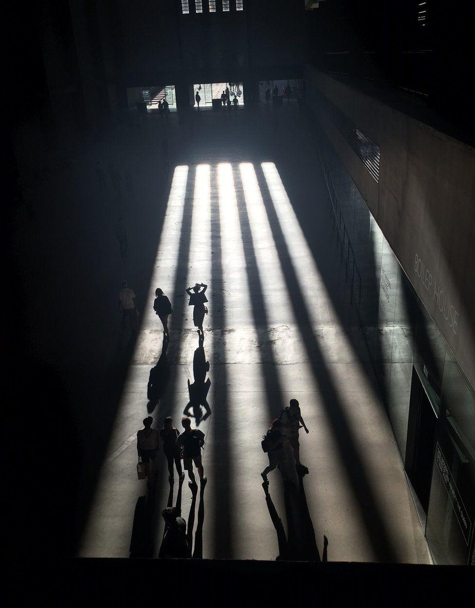Long shadows spread across the floor of the Tate Modern's Turbine Hall