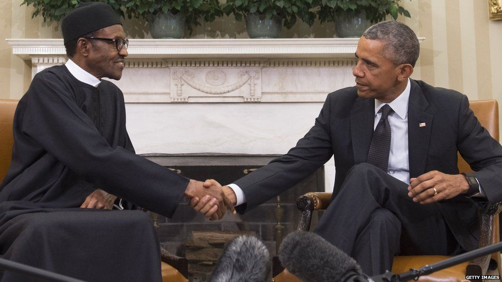 US President Barack Obama shakes hands with Nigerian President Muhammadu Buhari during a meeting in the Oval Office of the White House in Washington, DC, July 20, 2015.