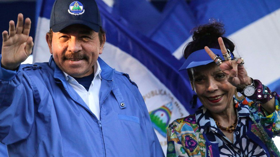 Nicaraguan President Daniel Ortega with his wife, Vice-President Rosario Murillo, gesture at supporters during a rally in Managua, 5 September 2018