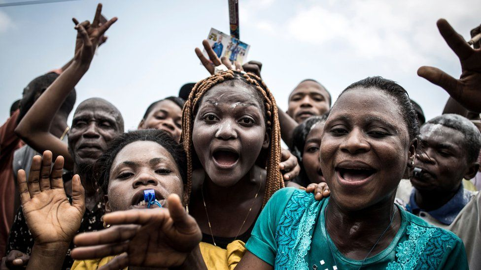 """Supporters of Felix Tshisekedi, who was named provisional winner of Democratic Republic of Congo""""s presidential election, celebrate outside the Union for Democracy and Social Progress (UDPS) headquarters in Kinshasa on January 10, 2019"""