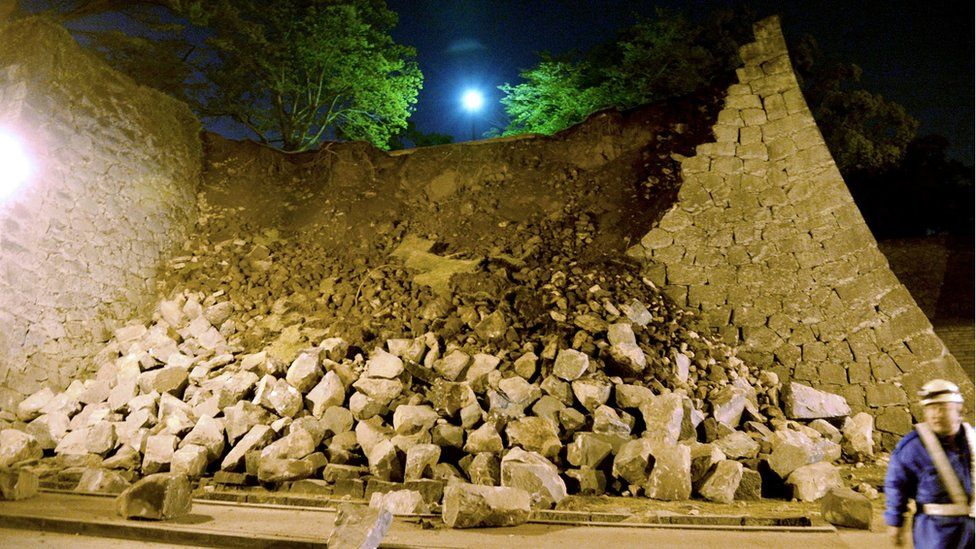 Stone walls of Kumamoto castle fall after an earthquake in Kumamoto, southern Japan, Thursday, April 14, 2016