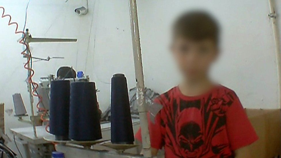 Young boy working in factory