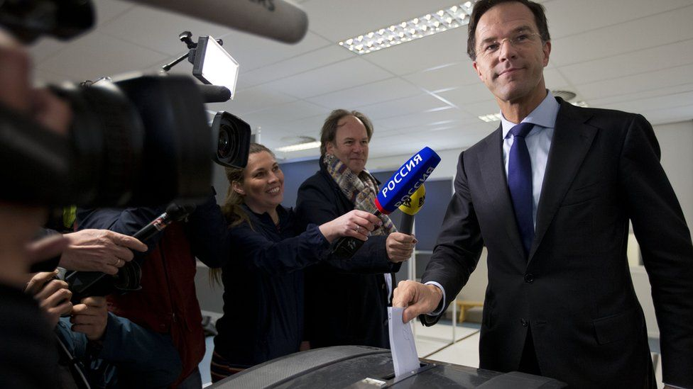Prime Minister Mark Rutte cast his vote in The Hague, as he was followed by a Russian TV crew (6 April)