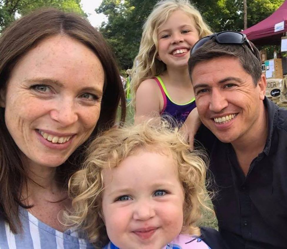 Iain pictured recently with his wife and children