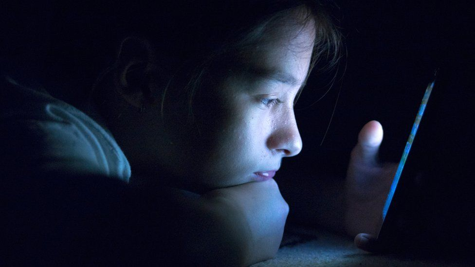 Young person in dark
