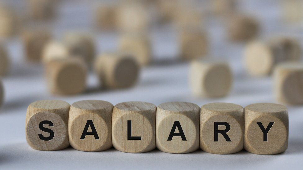 'Salary' spelt on wooden bricks
