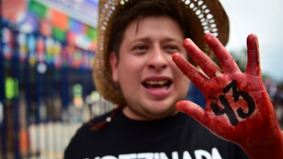 Relatives and friends of the 43 missing students from Ayotzinapa take part in a demonstration in Iguala