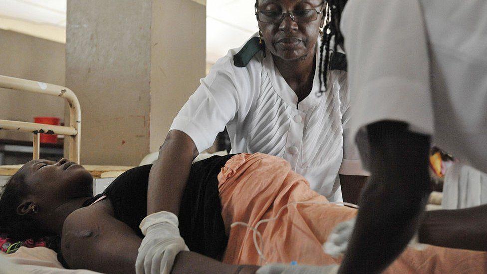 Nurses attending to a pregnant women in Sierra Leone