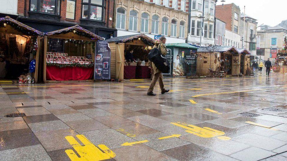 A man walks past Cardiff's Christmas market
