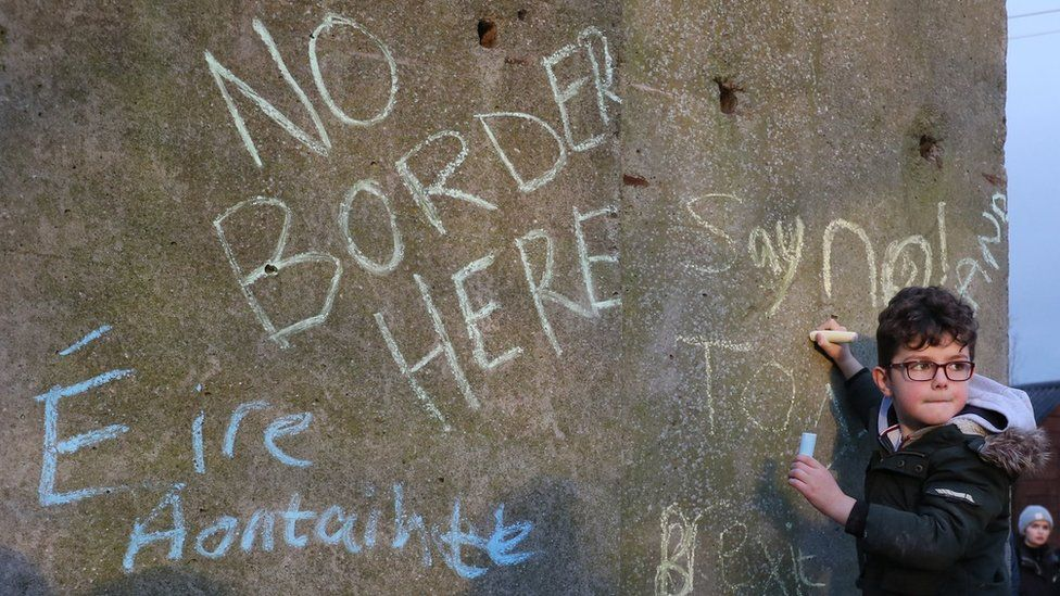 Boy at anti-border protest in County Louth