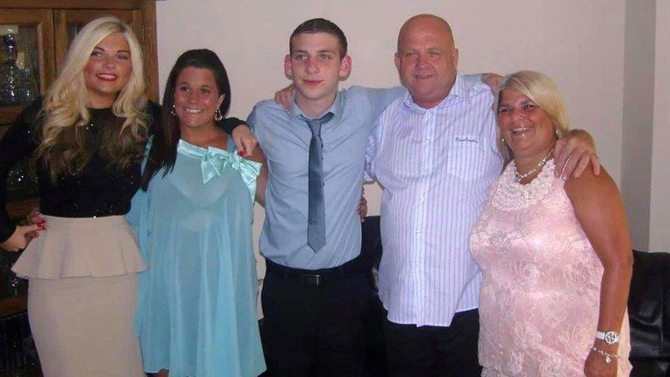 Jack Taylor (c) with family.