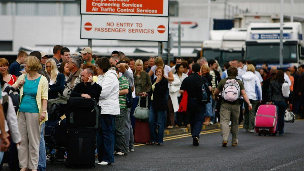 Passengers queue at Glasgow Airport after an incident with a car being driven at the airport's main terminal July 1, 2007 in Glasgow, Scotland.