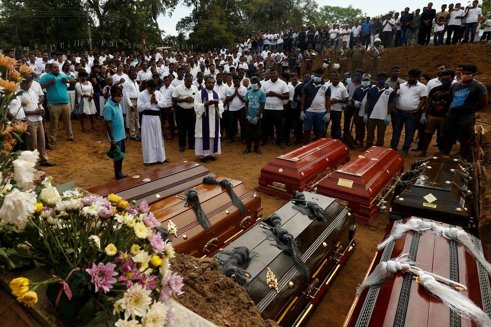 People participate in a mass funeral, for seven victims belonging to one family, in Negombo, Sri Lanka, 24 April