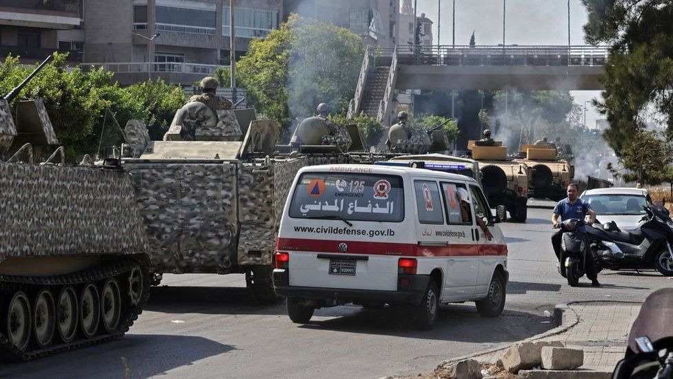 Lebanese army armoured personnel carriers and ambulances near the Palace of Justice in Beirut, Lebanon (14 October 2021)