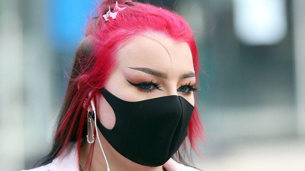 A woman in Belfast wearing a mask