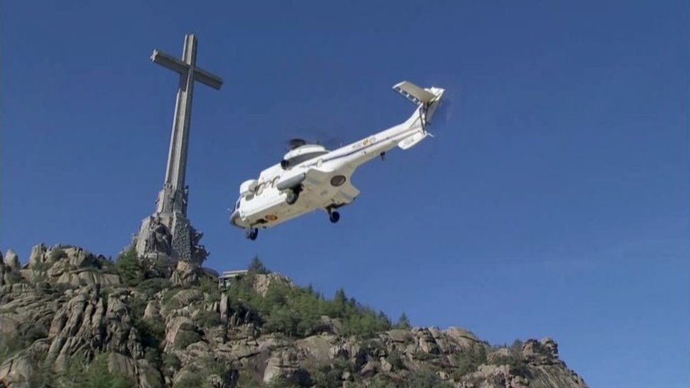 A helicopter carrying the coffin with the remains of Spanish late dictator Francisco Franco as it takes off in The Valley of the Fallen in San Lorenzo de El Escorial, Spain, 24 October 2019
