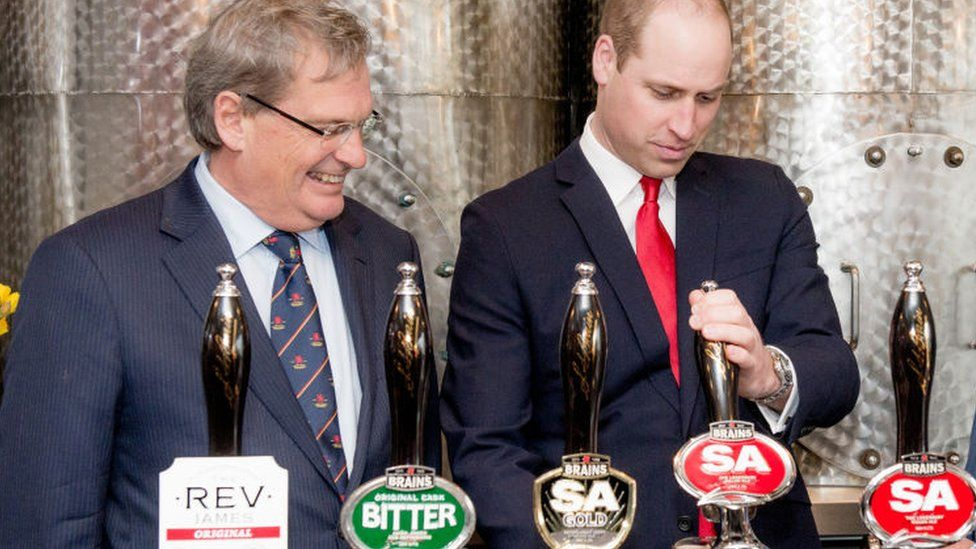 Prince William pulls a pint of Brains with Brains chairman John Rhys a few years ago