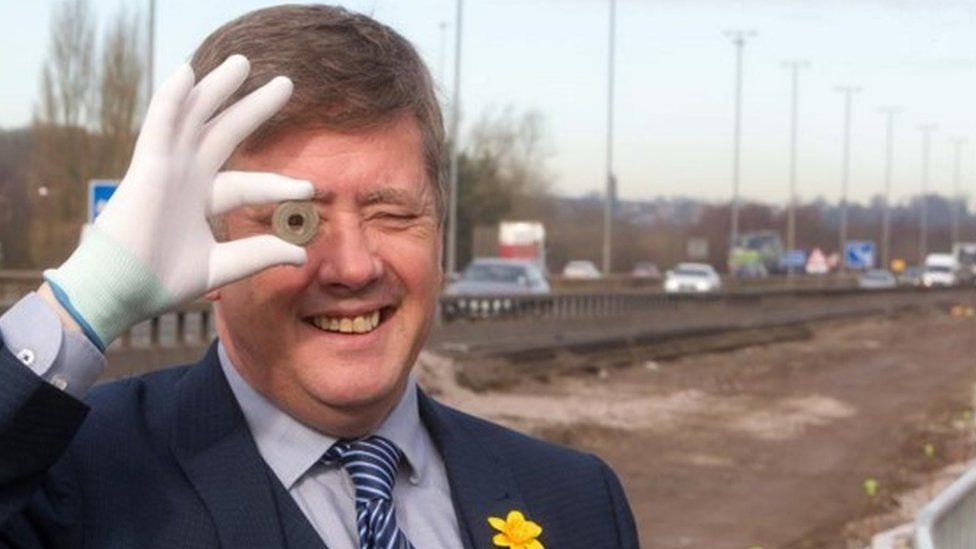 Infrastructure Minister Keith Brown with one of the artefacts