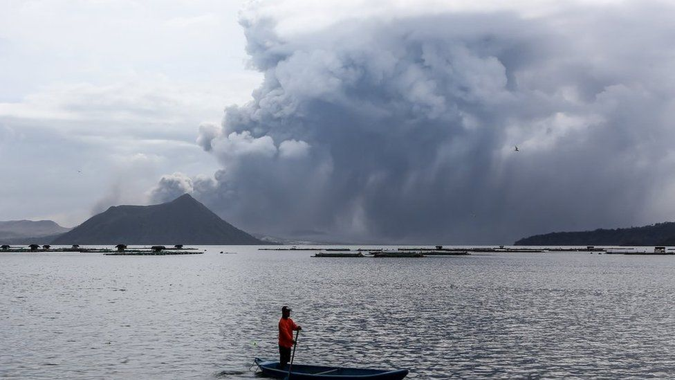 The Taal Vocano in the Philippines erupts with a huge plume of ash