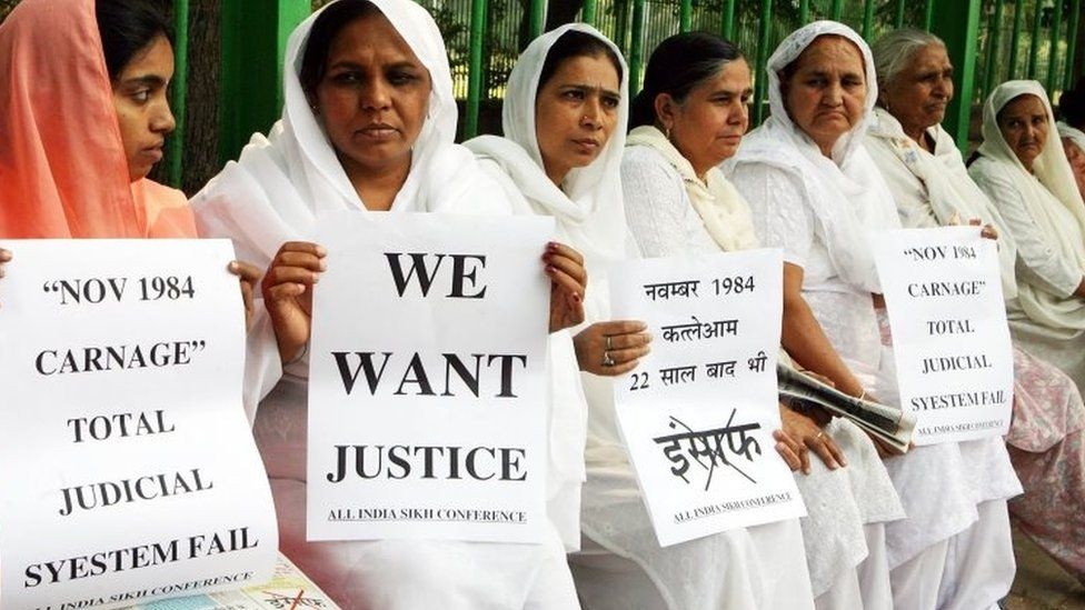 Relatives of victims of the 1984 riots hold placards demanding justice during a rally in Delhi, India. Photo: October 2018