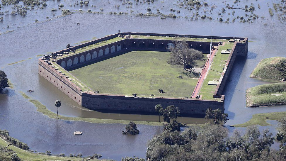 Historic Fort Pulaski National Monument is completely surrounded by flood waters in the aftermath of Hurricane Matthew on Sunday, Oct. 9, 2016, in Savannah, Ga