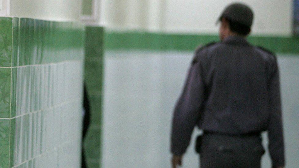 File photo showing a guard at Evin prison in Tehran, Iran (13 June 2006)