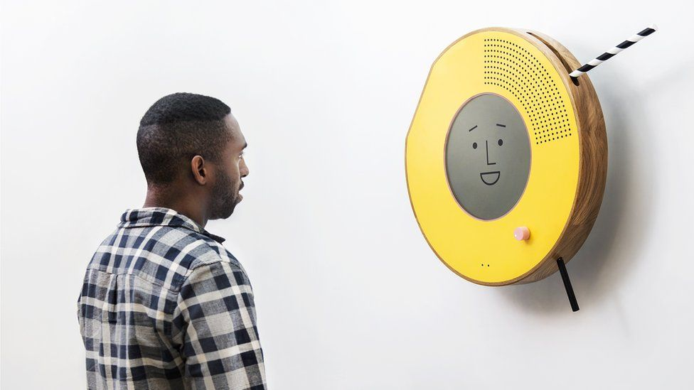 Solo radio on the wall with young man in front of it