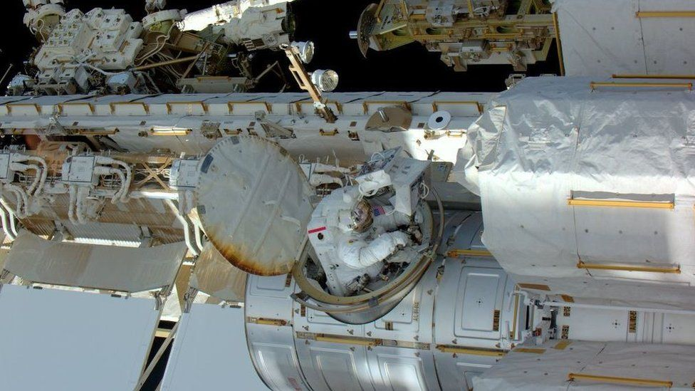 Tim Kopra coming through the airlock to the outside of the space station