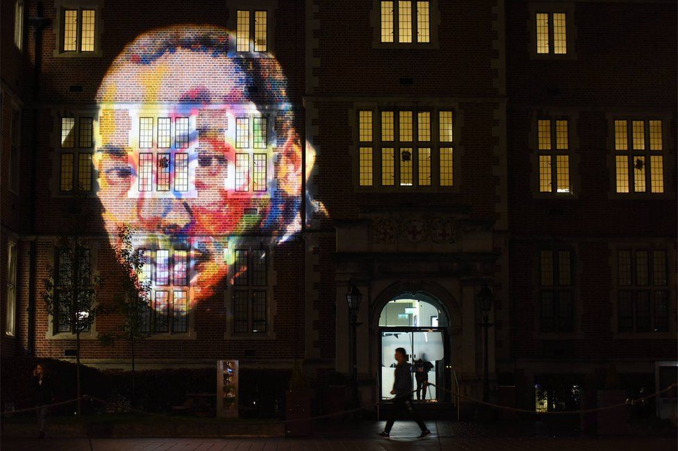 An image of Martin Luther King Jr – by artist Derek Russell - projected on to a Newcastle University building to mark the launch of Freedom City 2017