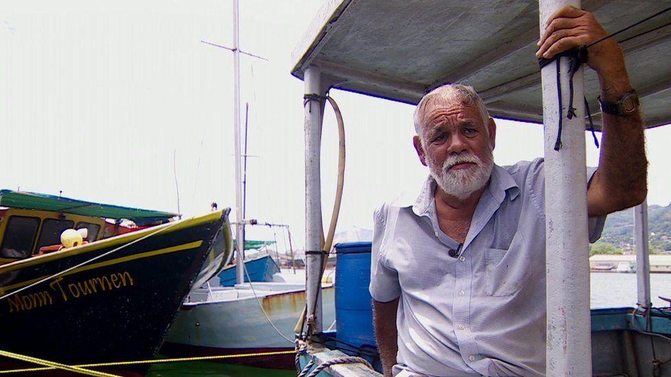 Fisherman Beatty Hoarau on his boat