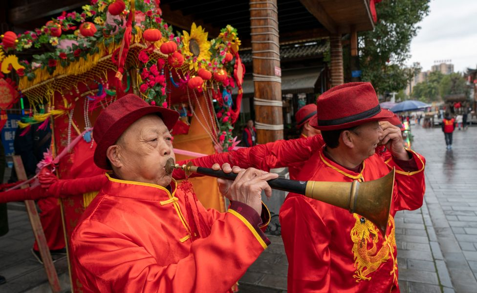 Bearers bring out the traditional Chinese red sedan chairs in Enshi, central Hubei province. Photo: 26 February 2021