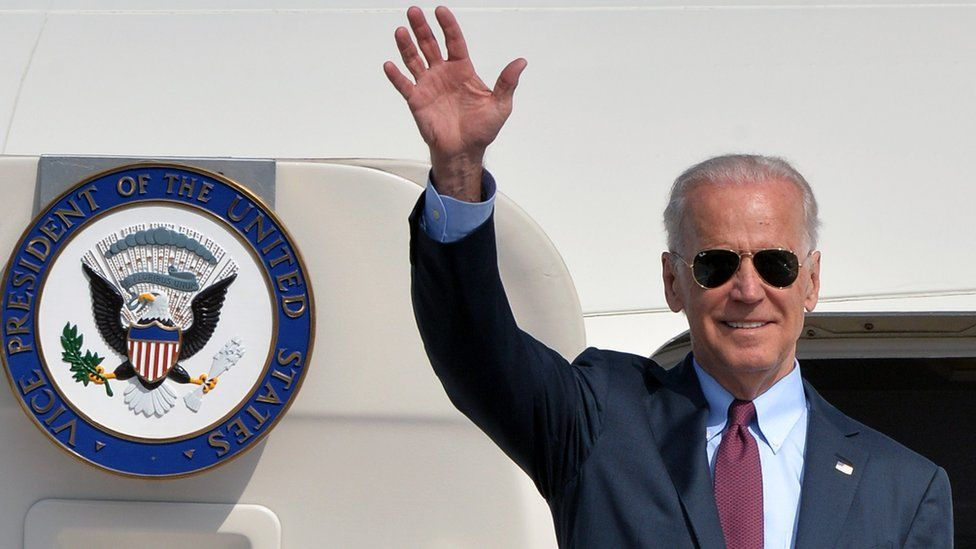 US Vice President Joe Biden waves after landing at the Boryspil airport in Kiev on April 21, 21014