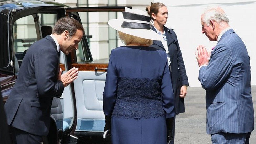 Emmanuel Macron meets the Prince of Wales and the Duchess of Cornwall