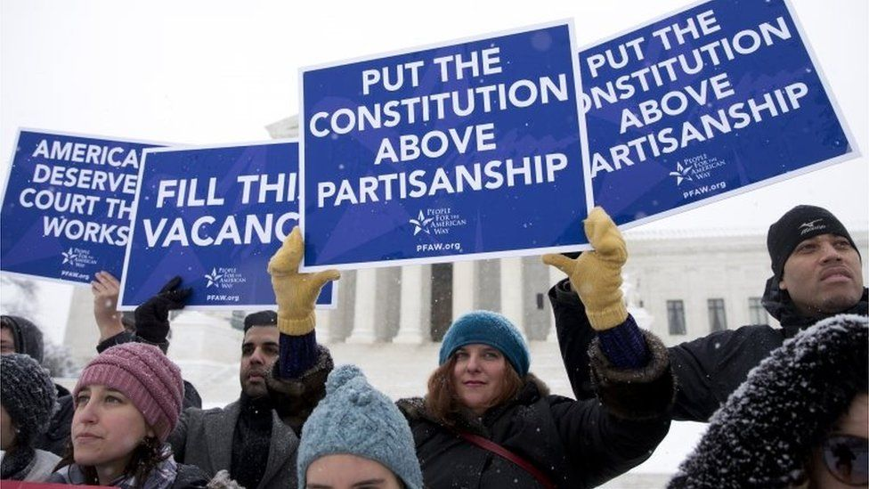 """A group with """"People for the American Way"""" from Washington, gather with signs in front of the US Supreme Court in Washington,on 15 February 2016"""