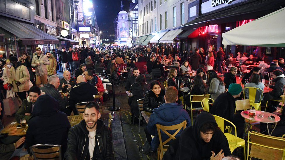 People enjoy their last night out in Soho before a four-week national lockdown
